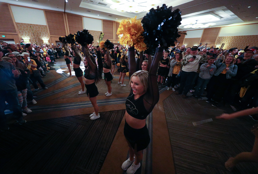 Members of the Iowa Spirit Squad perform during the Holiday Bowl Hawkeye Huddle Thursday, December 26, 2019 at the Hilton in downtown San Diego. (Brian Ray/hawkeyesports.com)