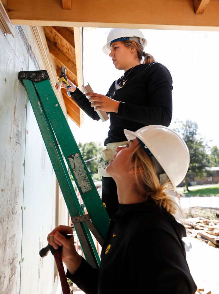 Iowa Hawkeyes guard Kathleen Doyle (22) and forward Hannah Stewart (21) work on the Habitat for Humanity Women's Build Wednesday, September 26, 2018 in Iowa City. (Brian Ray/hawkeyesports.com)