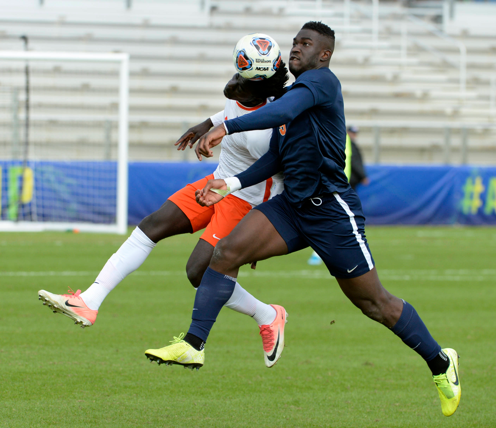 Clemson's Malick Mbaye (5) and Virginia's Daryl Dike (9) battle for the ball during the 2019 ACC Men?s Soccer Championship at WakeMed Soccer Park in Cary, N.C., Sunday Nov. 17, 2019. (Photo by Sara D. Davis, the ACC)
