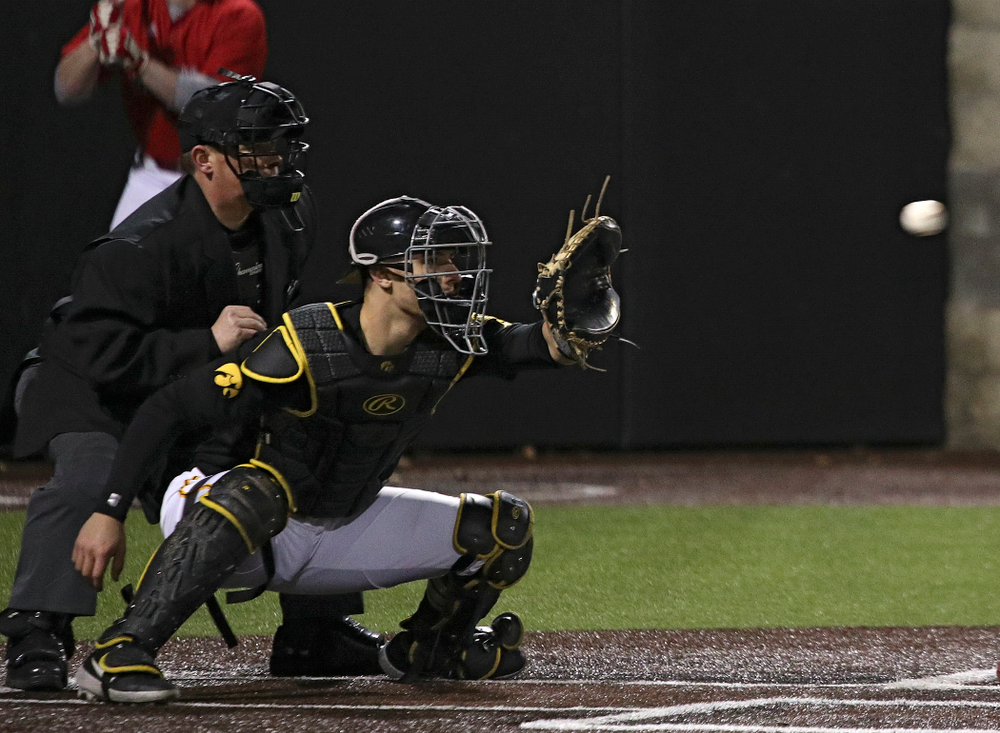 Iowa catcher Tyler Snep (16) looks in a throw during the eighth inning of their game at Duane Banks Field in Iowa City on Tuesday, March 3, 2020. (Stephen Mally/hawkeyesports.com)