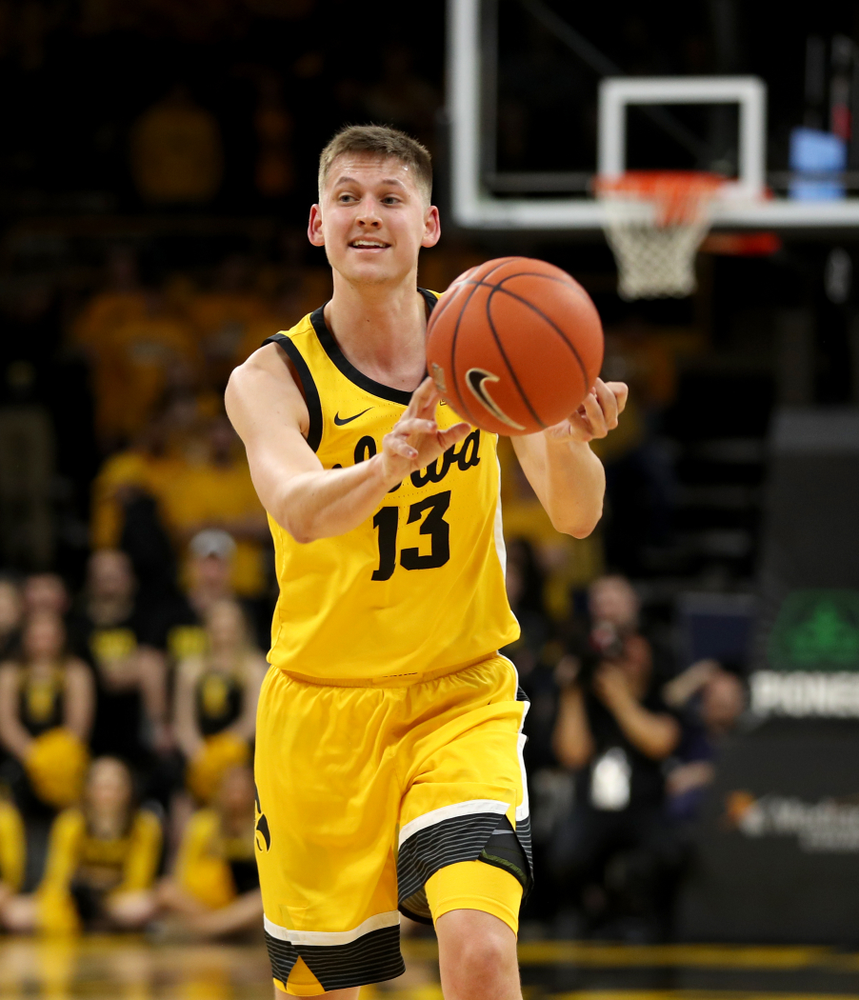Iowa Hawkeyes guard Austin Ash (13) against the Nebraska Cornhuskers Saturday, February 8, 2020 at Carver-Hawkeye Arena. (Brian Ray/hawkeyesports.com)
