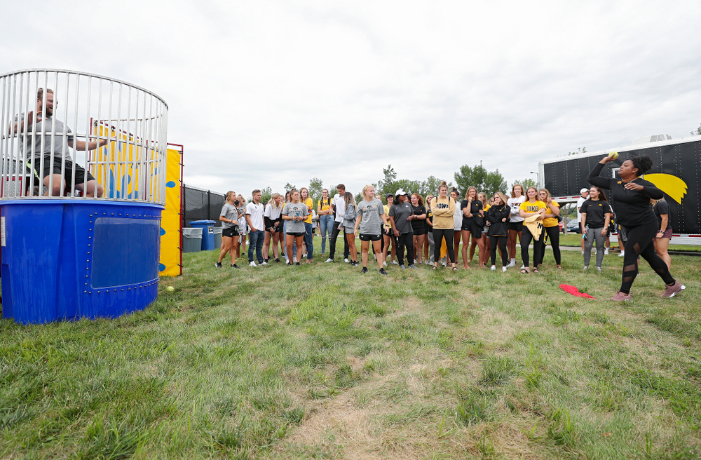 Iowa thrower Laulauga Tausaga tries to sink assistant coach Eric Werskey in the dunk tank during the Student-Athlete Kickoff outside the Karro Athletics Hall of Fame Building in Iowa City on Sunday, Aug 25, 2019. (Stephen Mally/hawkeyesports.com)