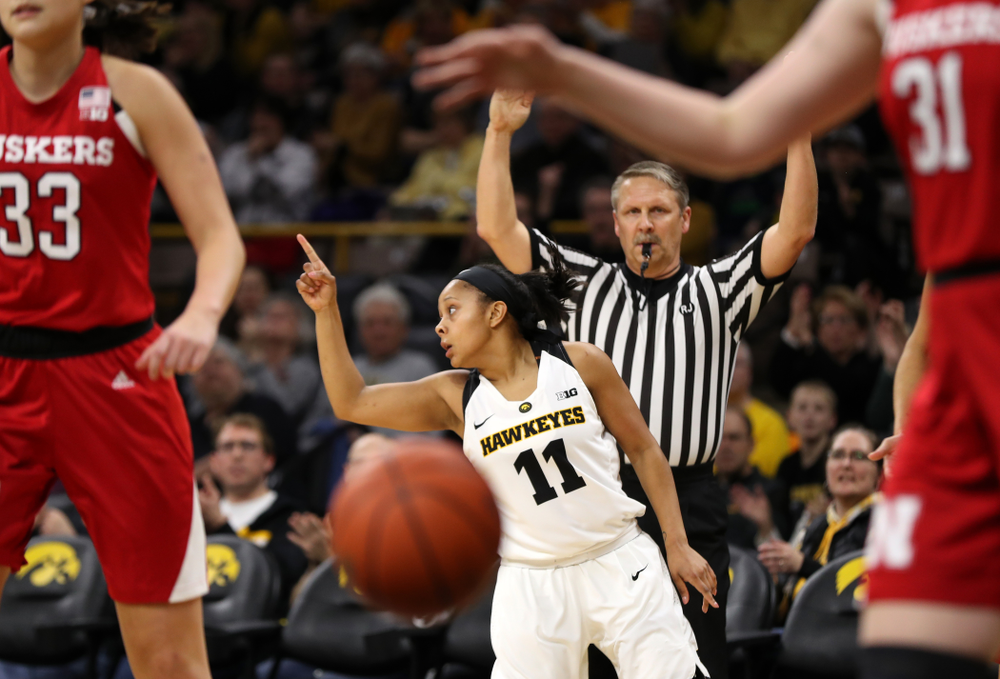 Iowa Hawkeyes guard Tania Davis (11) celebrates after knocking down a three point basket against the Nebraska Cornhuskers Thursday, January 3, 2019 at Carver-Hawkeye Arena. (Brian Ray/hawkeyesports.com)