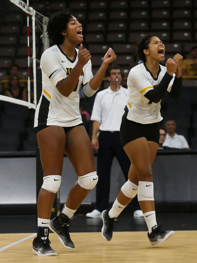 Iowa Hawkeyes middle blocker Amiya Jones (9), Iowa Hawkeyes setter Brie Orr (7)