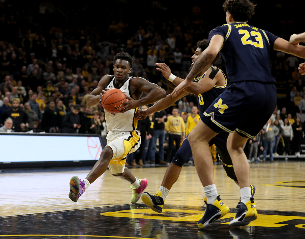 Iowa Hawkeyes guard Joe Toussaint (1) drives to the hoop against the Michigan Wolverines Friday, January 17, 2020 at Carver-Hawkeye Arena. (Brian Ray/hawkeyesports.com)