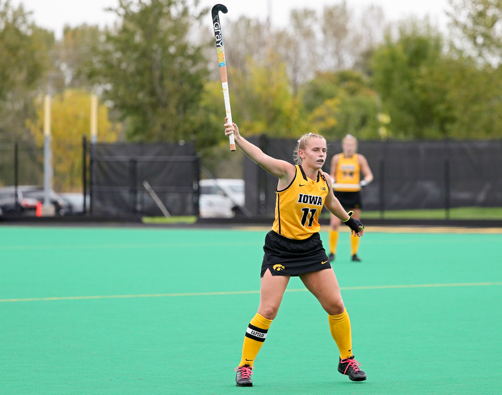 Iowa's Katie Birch (11) raises her stick in the air to try to block a pass during the second quarter of their game against UC Davis at Grant Field in Iowa City on Sunday, Oct 6, 2019. (Stephen Mally/hawkeyesports.com)