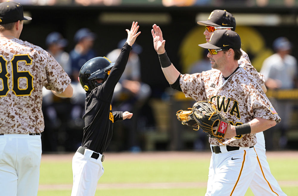 Iowa Hawkeyes left fielder Chris Whelan (28) is greeted as he runs back to the bench after making a diving catch for the final out of the top of third inning of their game against UC Irvine at Duane Banks Field in Iowa City on Sunday, May. 5, 2019. (Stephen Mally/hawkeyesports.com)