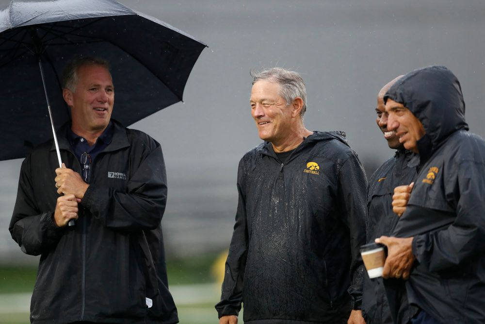 Iowa Hawkeyes head coach Kirk Ferentz  talks with BTN's Gerry DiNardo, Howard Griffith, and Chuck Long during camp practice No. 15  Monday, August 20, 2018 at the Hansen Football Performance Center. (Brian Ray/hawkeyesports.com)