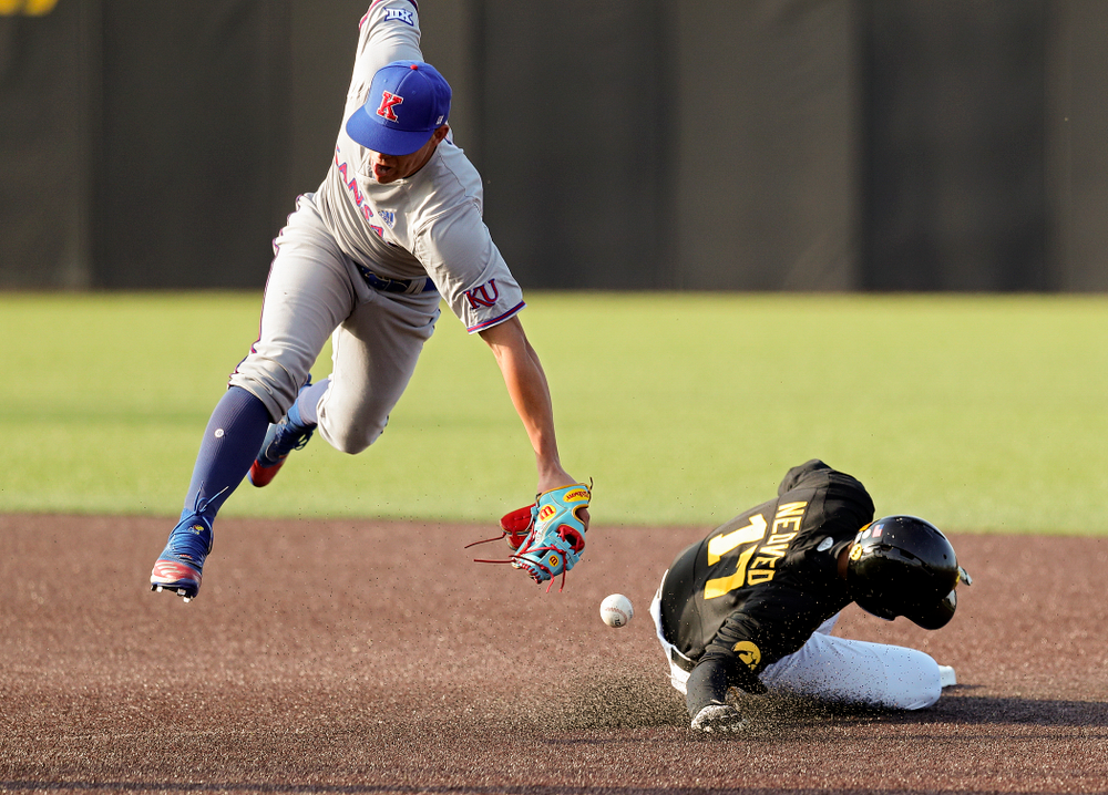 Iowa shortstop Dylan Nedved (17) steals second base during the third inning of their college baseball game at Duane Banks Field in Iowa City on Tuesday, March 10, 2020. (Stephen Mally/hawkeyesports.com)