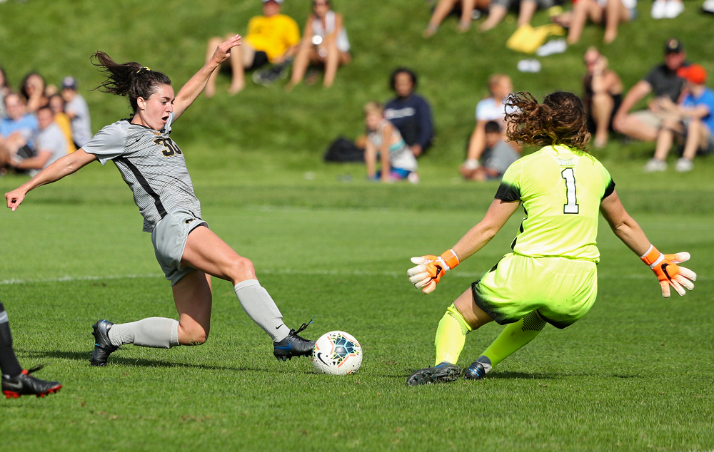 Iowa forward Devin Burns (30) tries to get the ball around the goalkeeper during the second half of their match at the Iowa Soccer Complex in Iowa City on Sunday, Sep 1, 2019. (Stephen Mally/hawkeyesports.com)