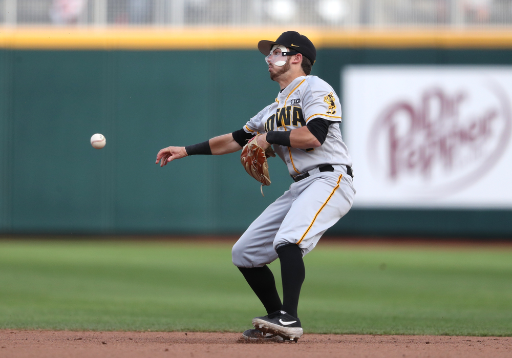 Iowa Hawkeyes infielder Mitchell Boe (4) turns a double play against the Indiana Hoosiers in the first round of the Big Ten Baseball Tournament Wednesday, May 22, 2019 at TD Ameritrade Park in Omaha, Neb. (Brian Ray/hawkeyesports.com)