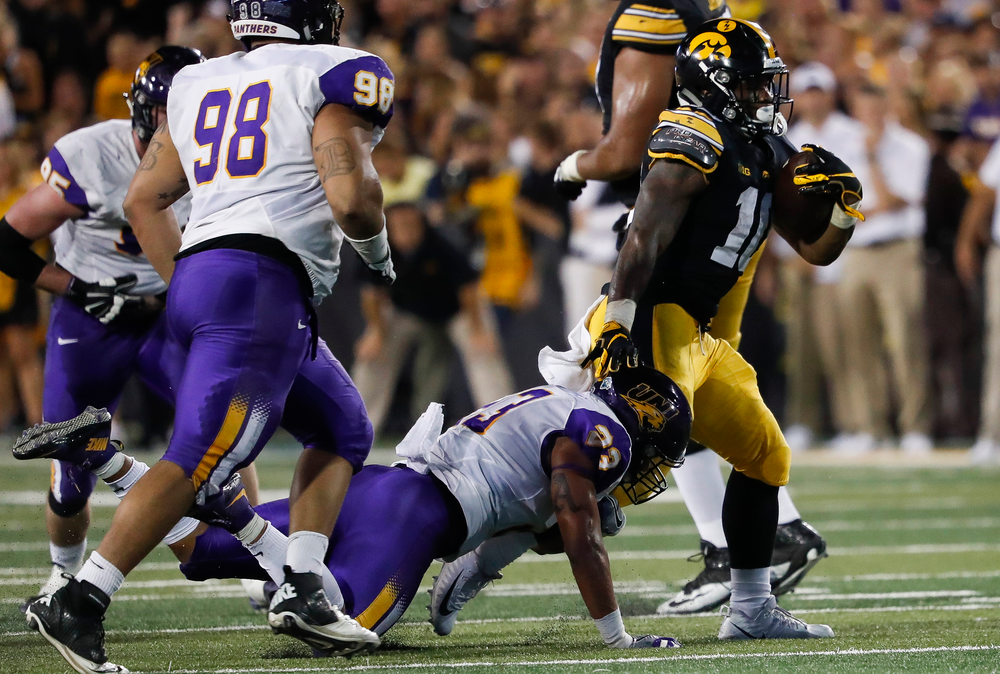 Iowa Hawkeyes running back Mekhi Sargent (10) breaks a tackle during a game against Northern Iowa at Kinnick Stadium on September 15, 2018. (Tork Mason/hawkeyesports.com)