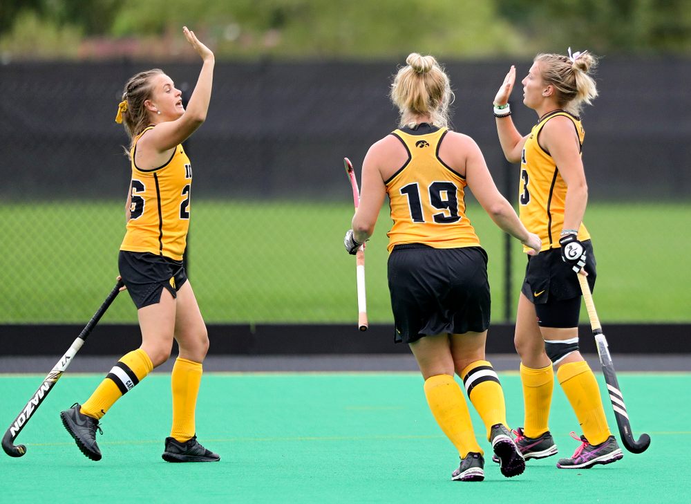 Iowa's Leah Zellner (right) celebrates her goal with Maddy Murphy (left) and Ryley Miller (19) during the first quarter of their game against UC Davis at Grant Field in Iowa City on Sunday, Oct 6, 2019. (Stephen Mally/hawkeyesports.com)
