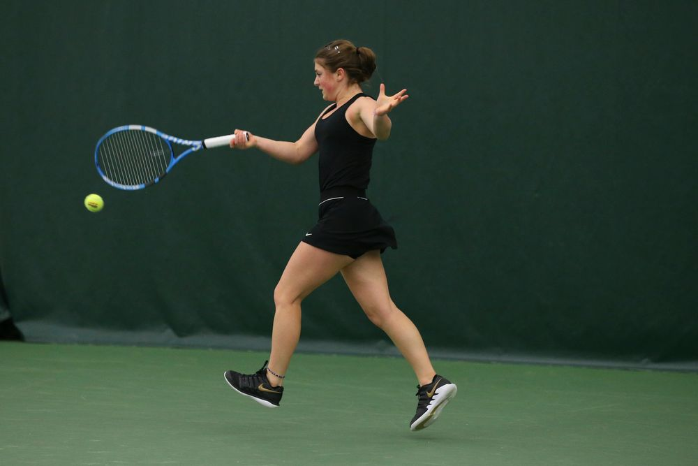 Iowa's Erika Dodridge returns a hit during the Iowa women's tennis meet vs UNI  on Saturday, February 29, 2020 at the Hawkeye Tennis and Recreation Complex. (Lily Smith/hawkeyesports.com)
