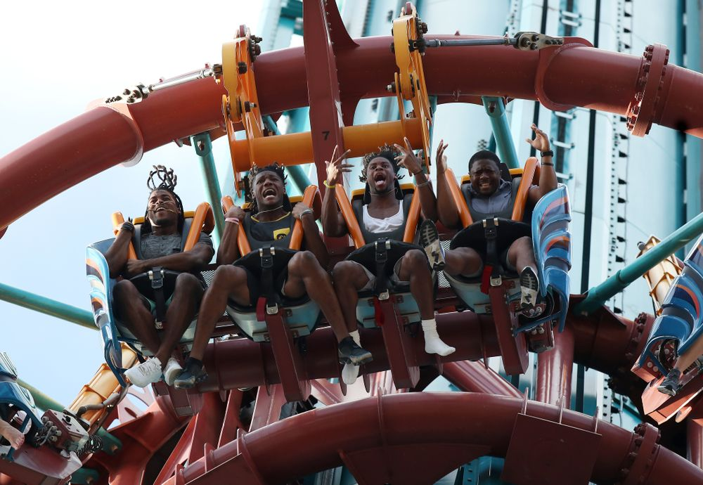 Iowa Hawkeyes defensive back Devonte Young (17), wide receiver Brandon Smith (12), wide receiver Ihmir Smith-Marsette (6), and and running backs coach Derrick Foster ride Falcon's Fury during an Outback Bowl team event Saturday, December 29, 2018 at Busch Gardens in Tampa, FL. (Brian Ray/hawkeyesports.com)
