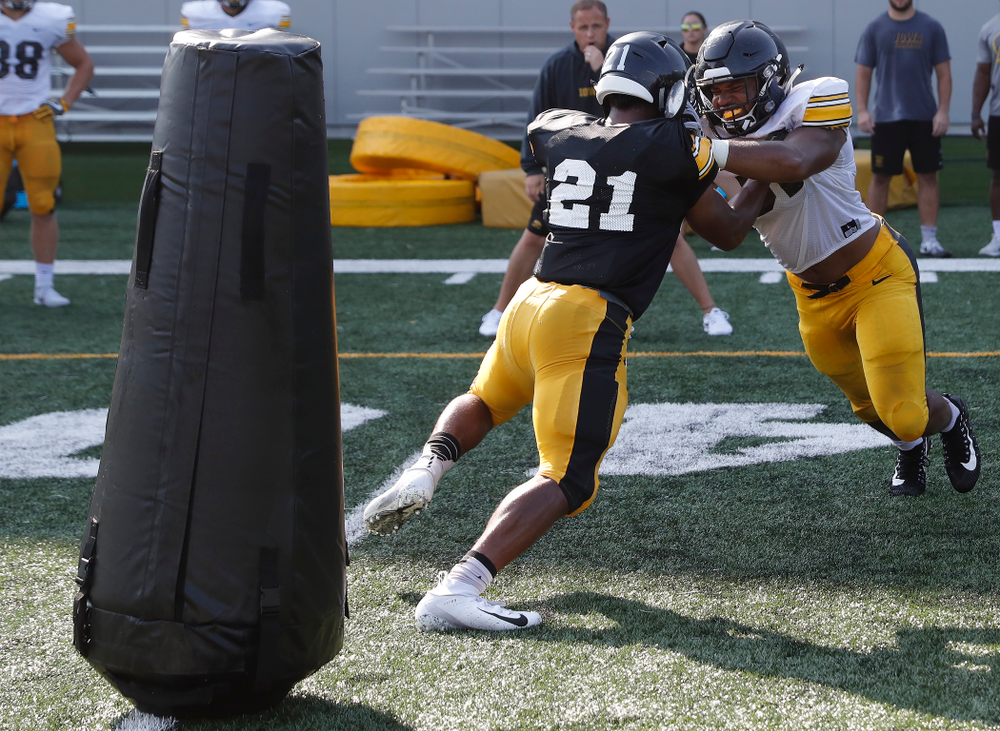 Iowa Hawkeyes running back Ivory Kelly-Martin (21) and linebacker Barrington Wade (35) during camp practice No. 17 Wednesday, August 22, 2018 at the Kenyon Football Practice Facility. (Brian Ray/hawkeyesports.com)