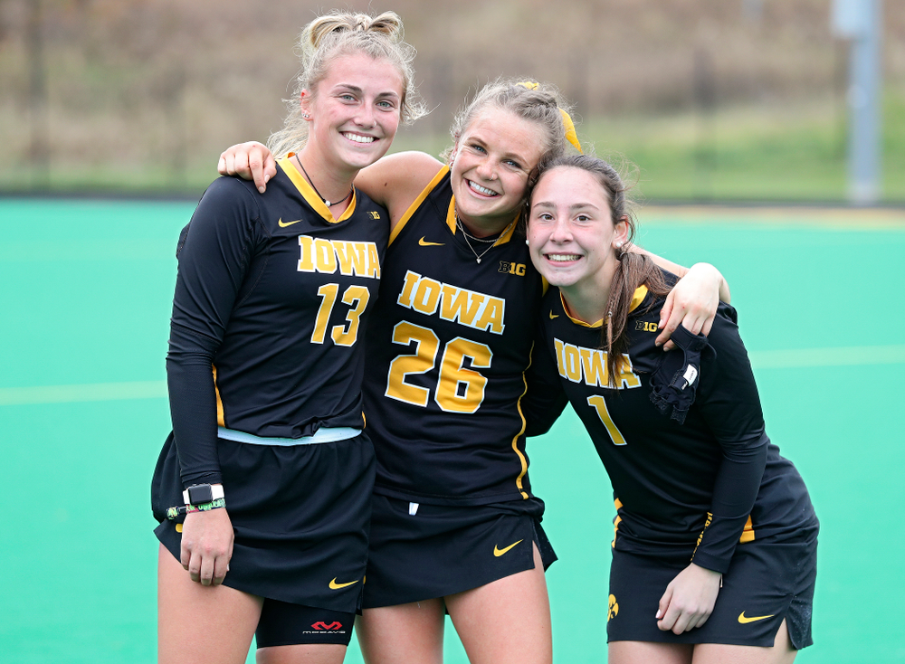 Iowa's Leah Zellner (13), Maddy Murphy (26), and Amy Gaiero (1) after winning their game at Grant Field in Iowa City on Saturday, Oct 26, 2019. (Stephen Mally/hawkeyesports.com)