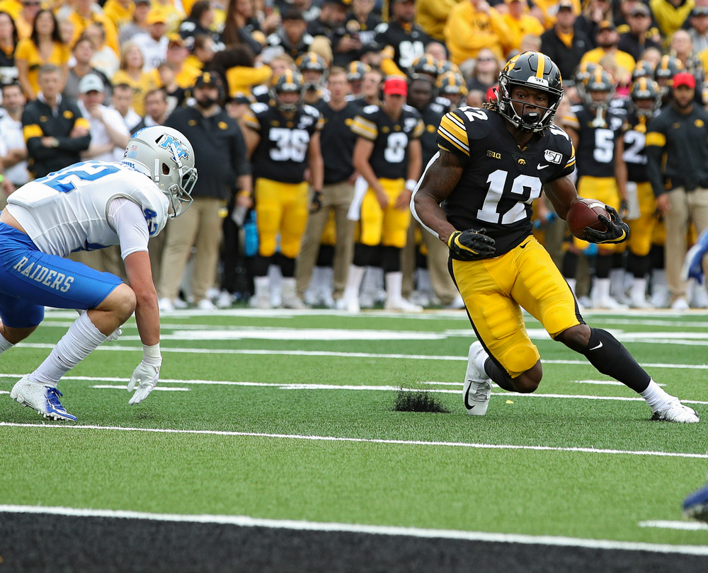Iowa Hawkeyes wide receiver Brandon Smith (12) on a 10-yard touchdown reception during fourth quarter of their game at Kinnick Stadium in Iowa City on Saturday, Sep 28, 2019. (Stephen Mally/hawkeyesports.com)