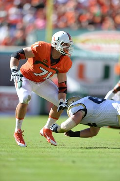 University of Miami Hurricanes defensive lineman Anthony Chickillo #71 plays in a game against the Georgia Tech Yellow Jackets at Sun Life Stadium on...