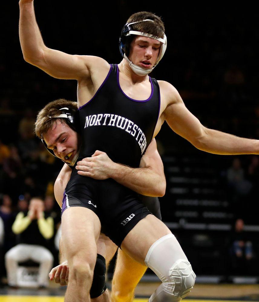 Iowa's Brandon Sorensen wrestles Northwestern's Ryan Deakin at 149 pounds
