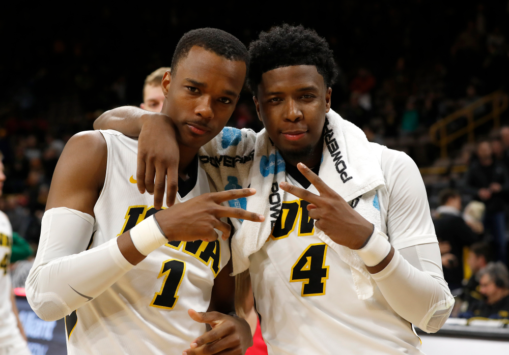 Iowa Hawkeyes guard Maishe Dailey (1) and guard Isaiah Moss (4)