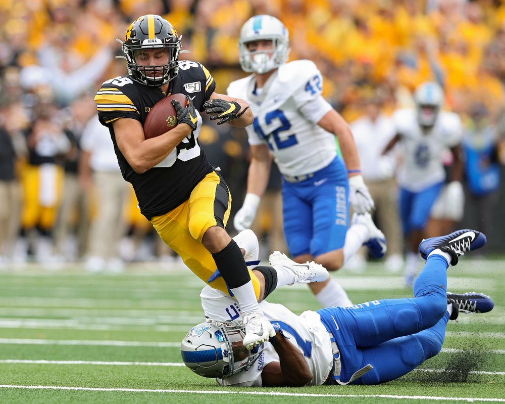 Iowa Hawkeyes wide receiver Nico Ragaini (89) is tripped up after cartching a pass during fourth quarter of their game at Kinnick Stadium in Iowa City on Saturday, Sep 28, 2019. (Stephen Mally/hawkeyesports.com)