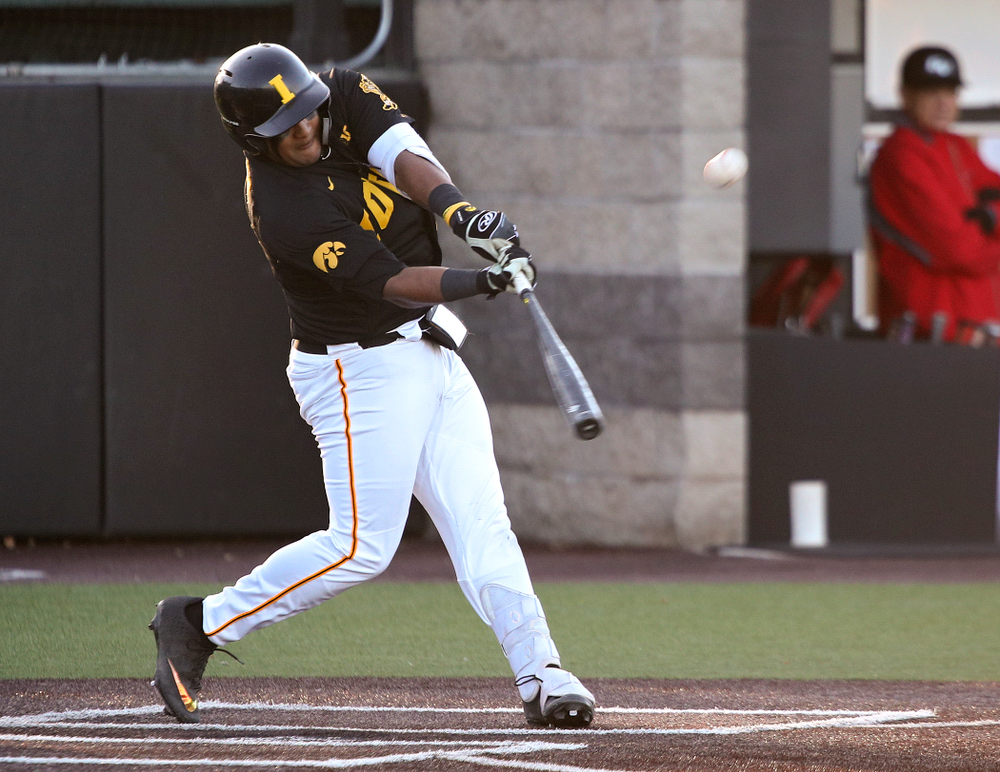 Iowa infielder Izaya Fullard (20) hits a triple during the third inning of their game at Duane Banks Field in Iowa City on Tuesday, March 3, 2020. (Stephen Mally/hawkeyesports.com)