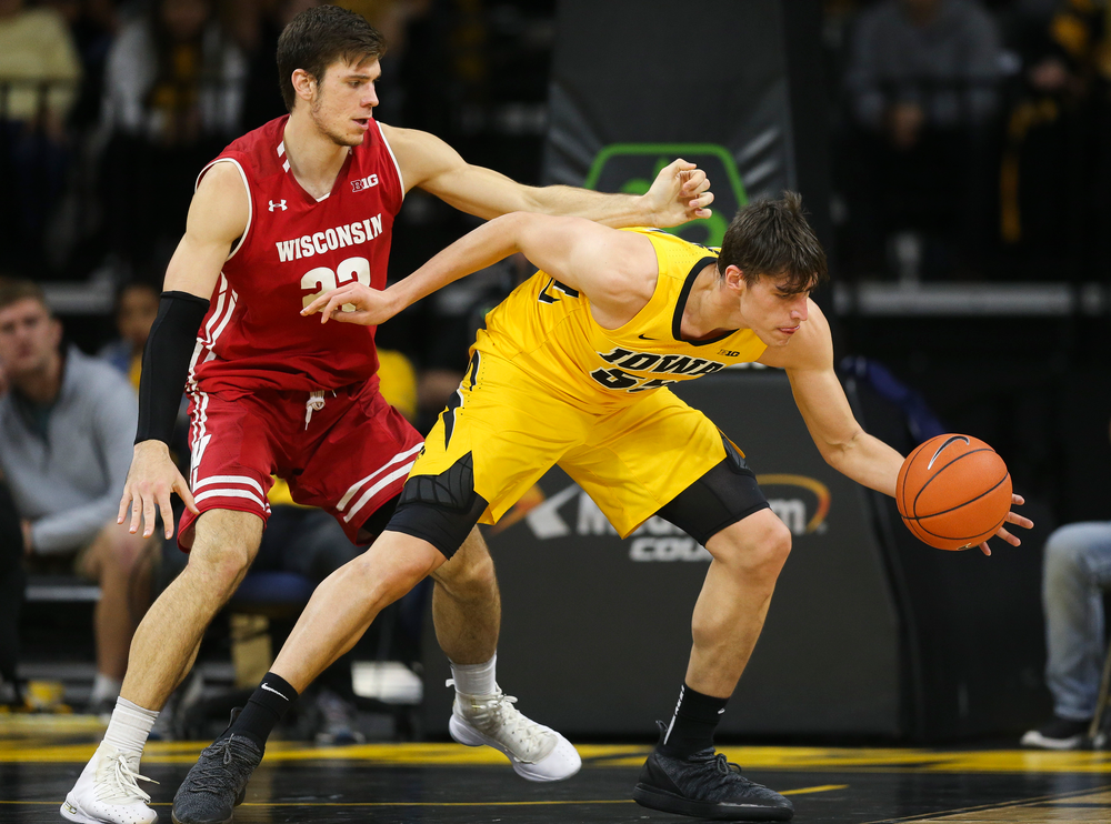 Iowa Hawkeyes forward Luka Garza (55) corrals a pass against Wisconsin on November 30, 2018 at Carver-Hawkeye Arena. (Tork Mason/hawkeyesports.com)