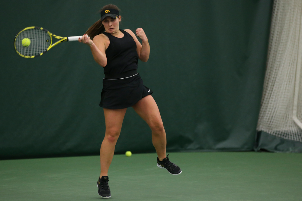 Iowa's Danielle Bauers returns a hit during the Iowa women's tennis meet vs UNI  on Saturday, February 29, 2020 at the Hawkeye Tennis and Recreation Complex. (Lily Smith/hawkeyesports.com)