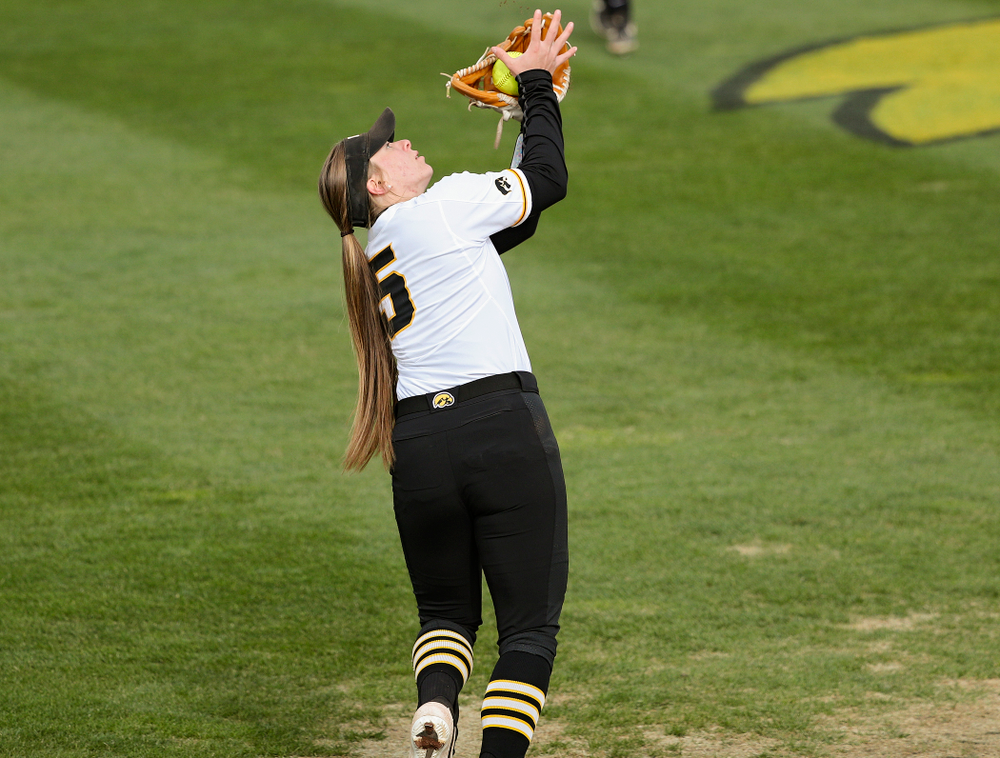 Iowa shortstop Sydney Owens (5) pulls in a pop up for an out during the third inning of their game against Illinois at Pearl Field in Iowa City on Friday, Apr. 12, 2019. (Stephen Mally/hawkeyesports.com)