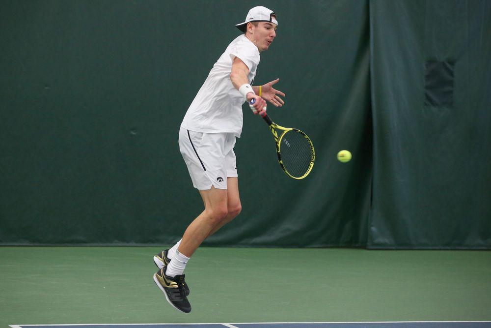 Iowa's Nikita Snezhko returns a hit during the Iowa men's tennis meet vs Nebraska on Sunday, March 1, 2020 at the Hawkeye Tennis and Recreation Complex. (Lily Smith/hawkeyesports.com)