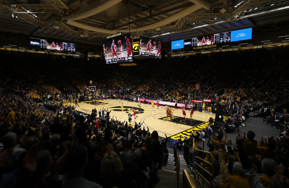 Fans celebrate a three point basket against the Nebraska Cornhuskers Saturday, February 8, 2020 at Carver-Hawkeye Arena. (Brian Ray/hawkeyesports.com)