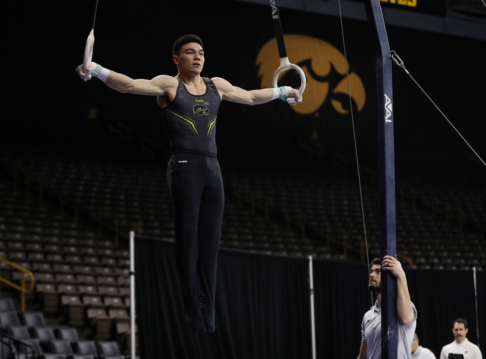 Iowa's Andrew Herrador competes on the rings against Oklahoma Saturday, February 9, 2019 at Carver-Hawkeye Arena. (Brian Ray/hawkeyesports.com)