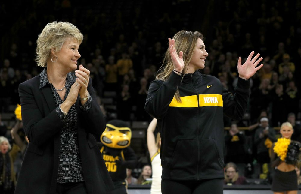 Former Hawkeye Hannah Stewart waves after being introduced before their game against Clemson Wednesday, December 4, 2019 at Carver-Hawkeye Arena. (Brian Ray/hawkeyesports.com)