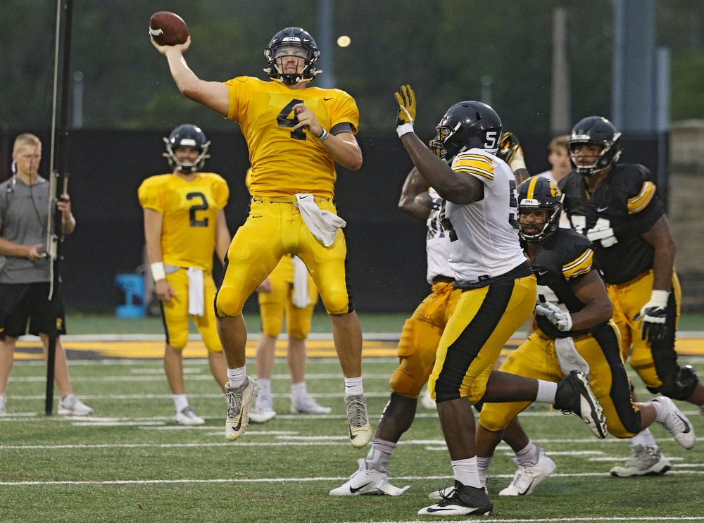 Iowa Hawkeyes quarterback Nate Stanley (4) throws while on the run durning Fall Camp Practice No. 17 at the Hansen Football Performance Center in Iowa City on Wednesday, Aug 21, 2019. (Stephen Mally/hawkeyesports.com)