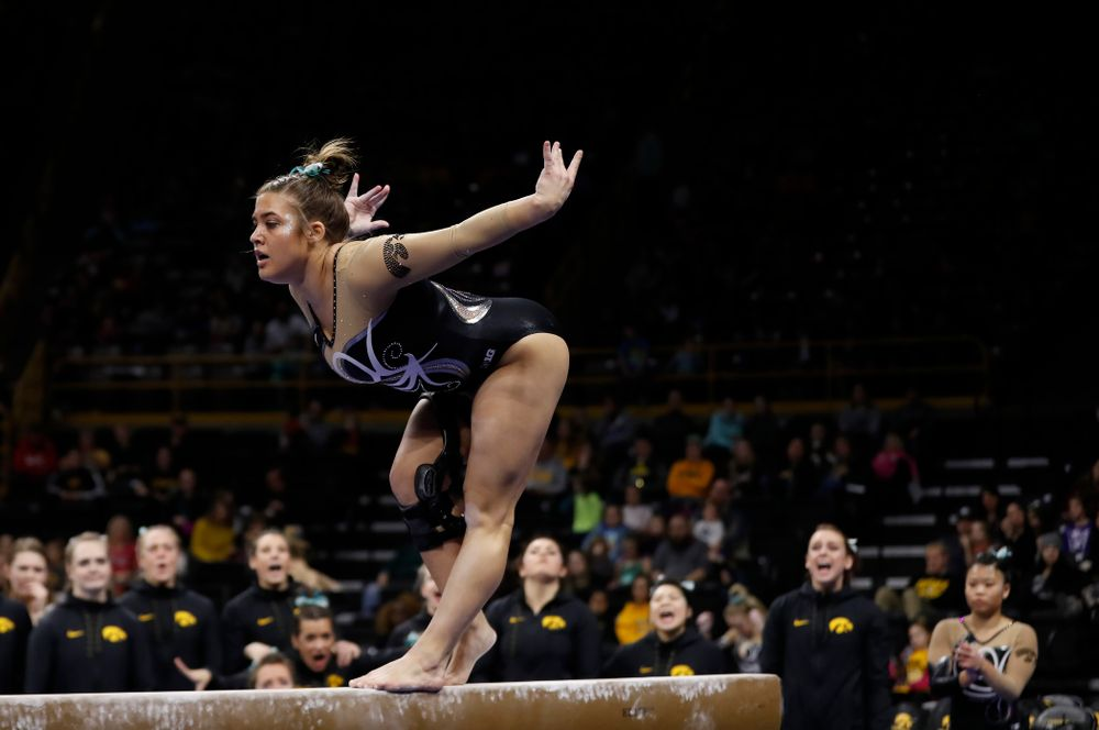 Iowa's Rose Piorkowski competes on the beam against the Nebraska Cornhuskers