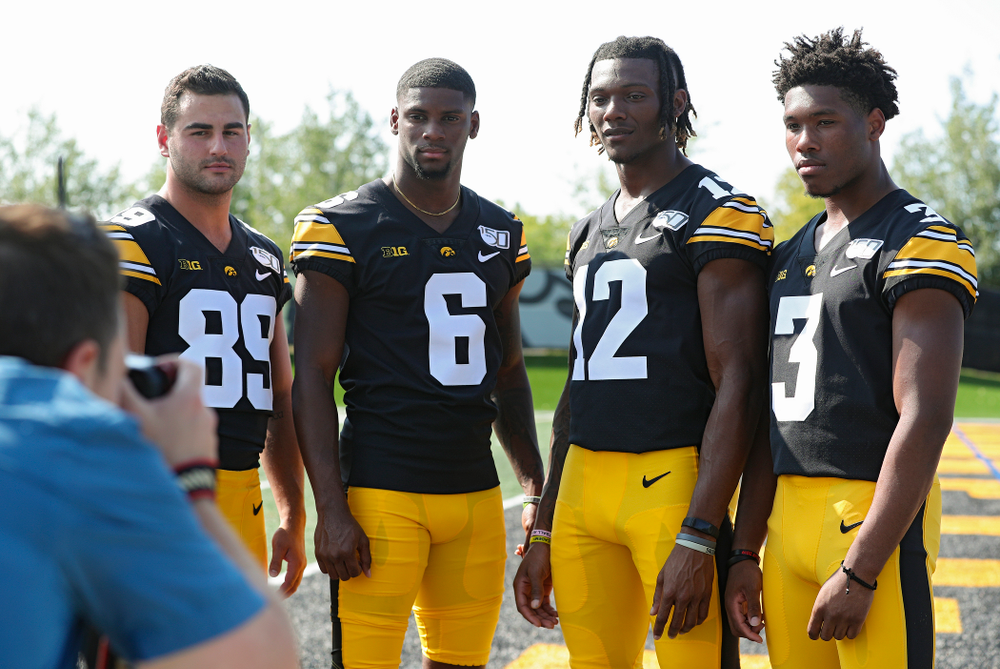 Iowa Hawkeyes wide receiver Nico Ragaini (89), wide receiver Ihmir Smith-Marsette (6), wide receiver Brandon Smith (12), and wide receiver Tyrone Tracy Jr. (3) pose for a picture during Iowa Football Media Day at the Hansen Football Performance Center in Iowa City on Friday, Aug 9, 2019. (Stephen Mally/hawkeyesports.com)