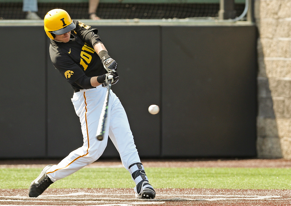 Iowa Hawkeyes shortstop Tanner Wetrich (16) hits a solo home run during the second inning of their game against Rutgers at Duane Banks Field in Iowa City on Saturday, Apr. 6, 2019. (Stephen Mally/hawkeyesports.com)