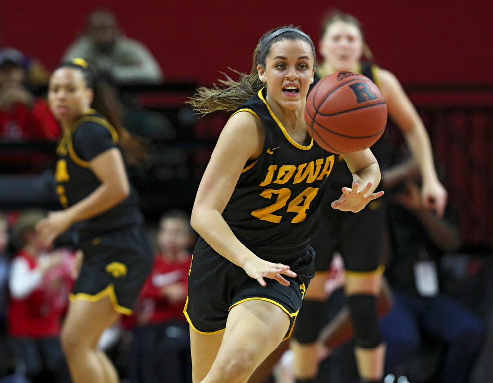 Iowa guard Gabbie Marshall (24) eyes a loose ball during the third quarter of their game at the Rutgers Athletic Center in Piscataway, N.J. on Sunday, March 1, 2020. (Stephen Mally/hawkeyesports.com)