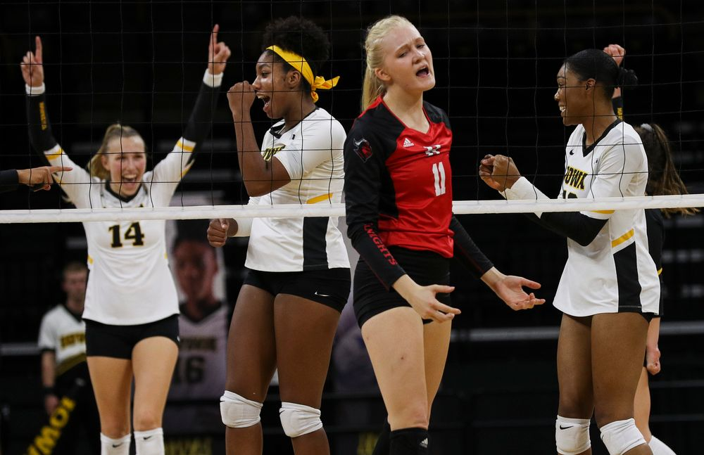 Iowa Hawkeyes middle blocker Amiya Jones (9) and Iowa Hawkeyes outside hitter Taylor Louis (16) celebrate after winning a point during a match against Rutgers at Carver-Hawkeye Arena on November 2, 2018. (Tork Mason/hawkeyesports.com)