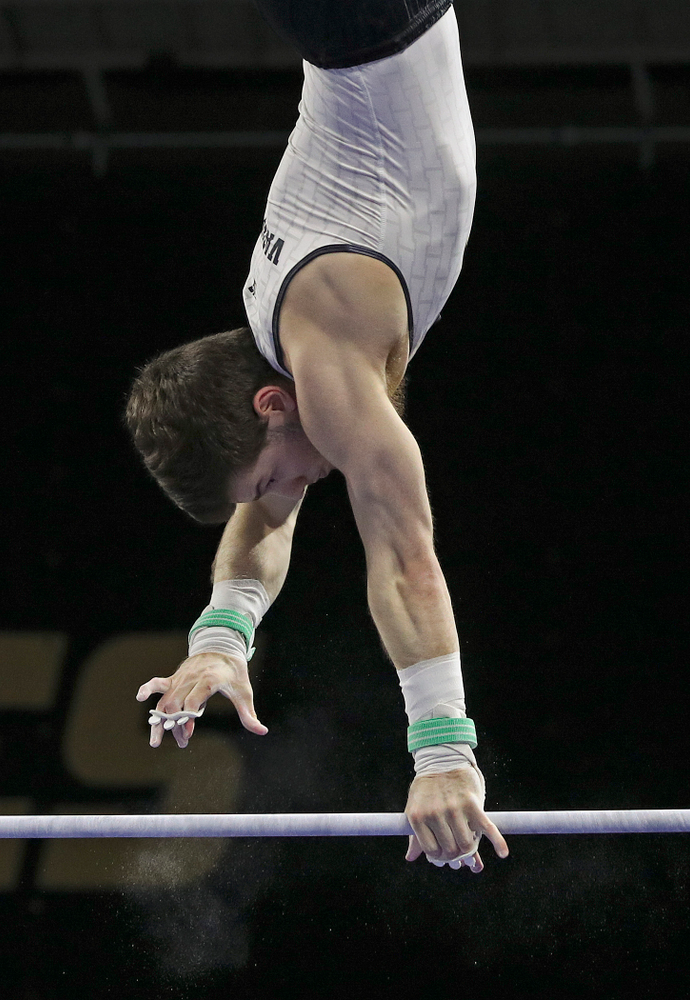 Iowa's Rogelio Vazquez competes in the horizontal bar during the second day of the Big Ten Men's Gymnastics Championships at Carver-Hawkeye Arena in Iowa City on Saturday, Apr. 6, 2019. (Stephen Mally/hawkeyesports.com)