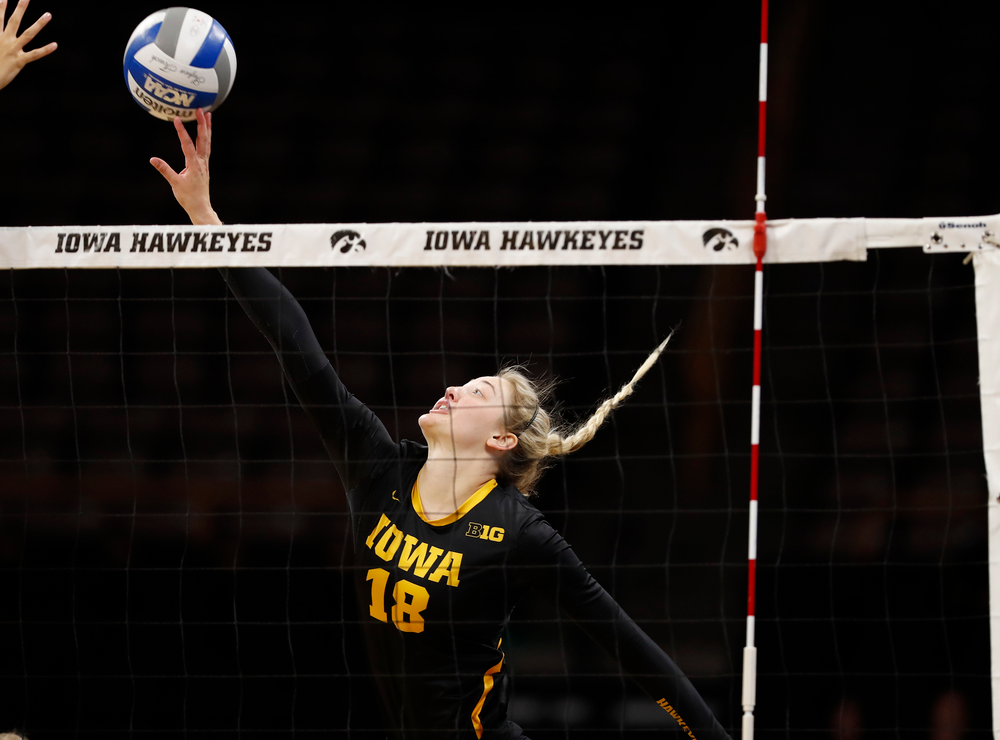 Iowa Hawkeyes outside hitter Lauren Brobst (18)