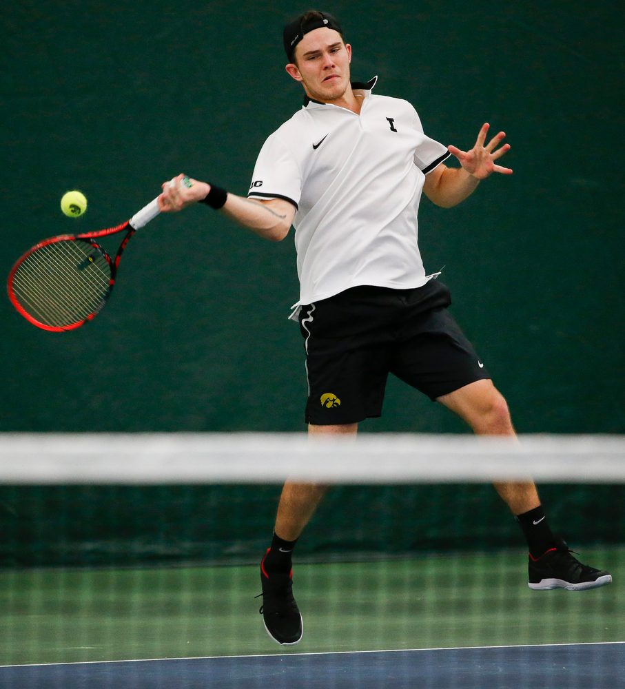 Iowa's Jonas Larsen returns a shot