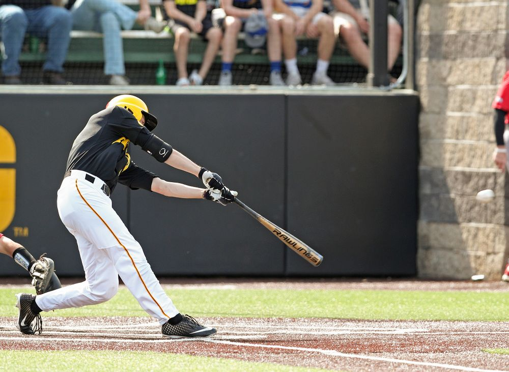 Iowa Hawkeyes center fielder Ben Norman (9) hits an RBI double during the sixth inning of their game against Rutgers at Duane Banks Field in Iowa City on Saturday, Apr. 6, 2019. (Stephen Mally/hawkeyesports.com)