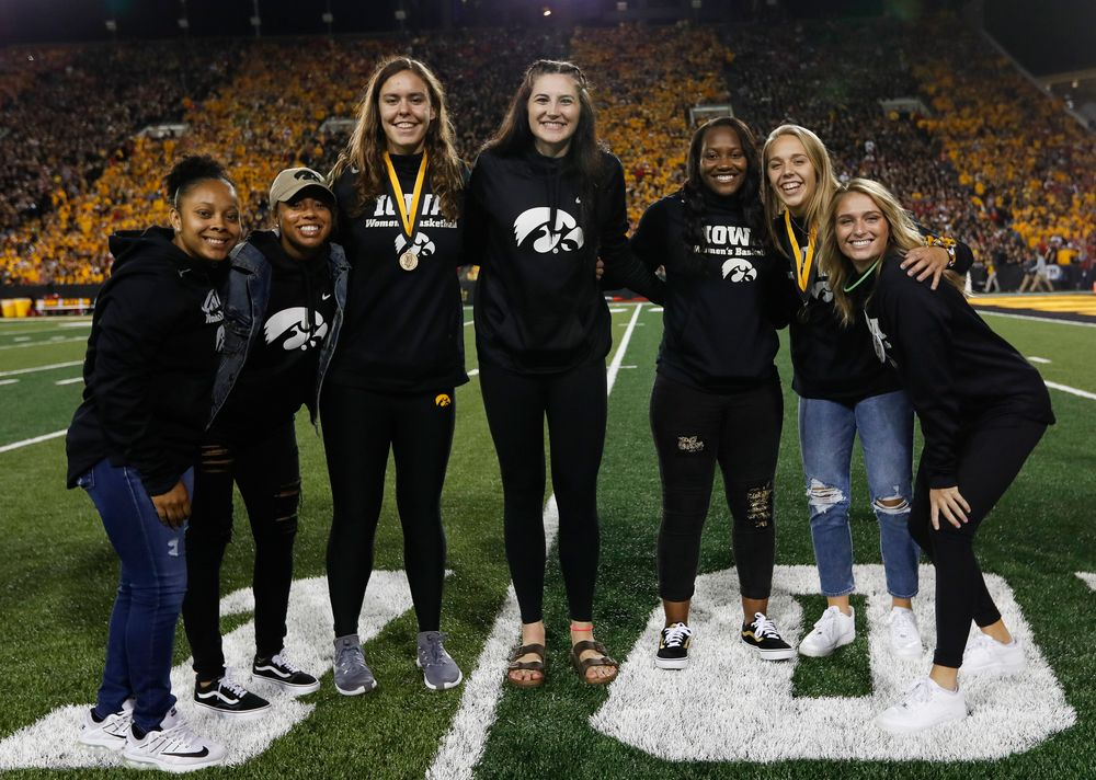 Members of the Iowa women's basketball team are recognized by the Presidential Committee on Athletics at halftime during a game against Wisconsin on September 22, 2018. (Tork Mason/hawkeyesports.com)