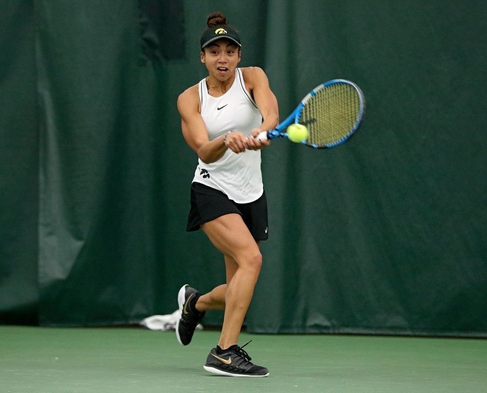 Iowa's Michelle Bacalla returns a shot during her singles match at the Hawkeye Tennis and Recreation Complex in Iowa City on Sunday, February 16, 2020. (Stephen Mally/hawkeyesports.com)
