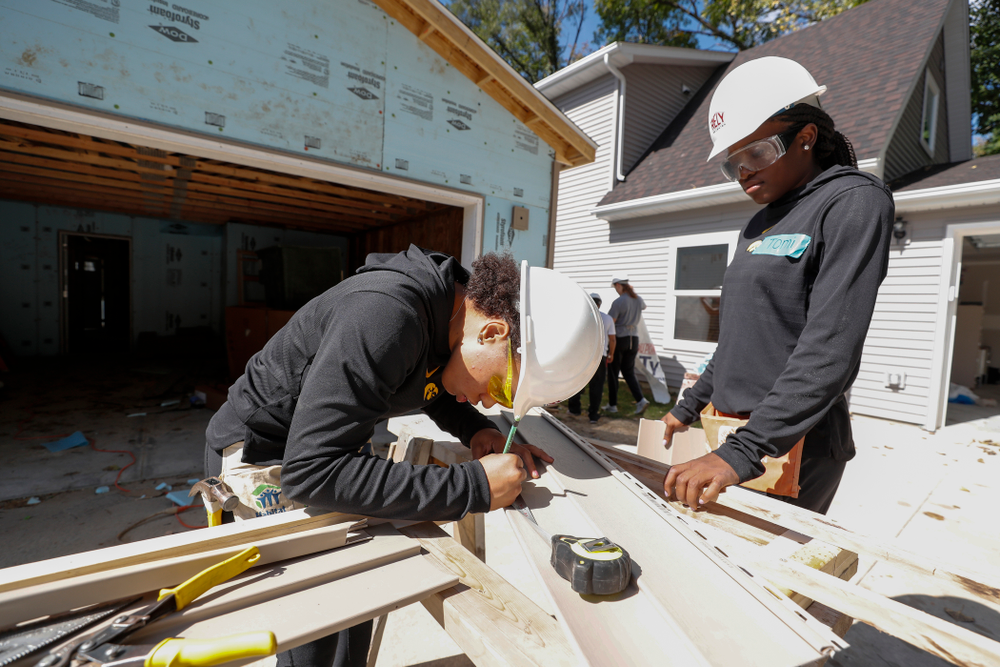 Iowa Hawkeyes guard Alexis Sevillian (5) and guard Tomi Taiwo (1) work on the Habitat for Humanity Women's Build Wednesday, September 26, 2018 in Iowa City. (Brian Ray/hawkeyesports.com)