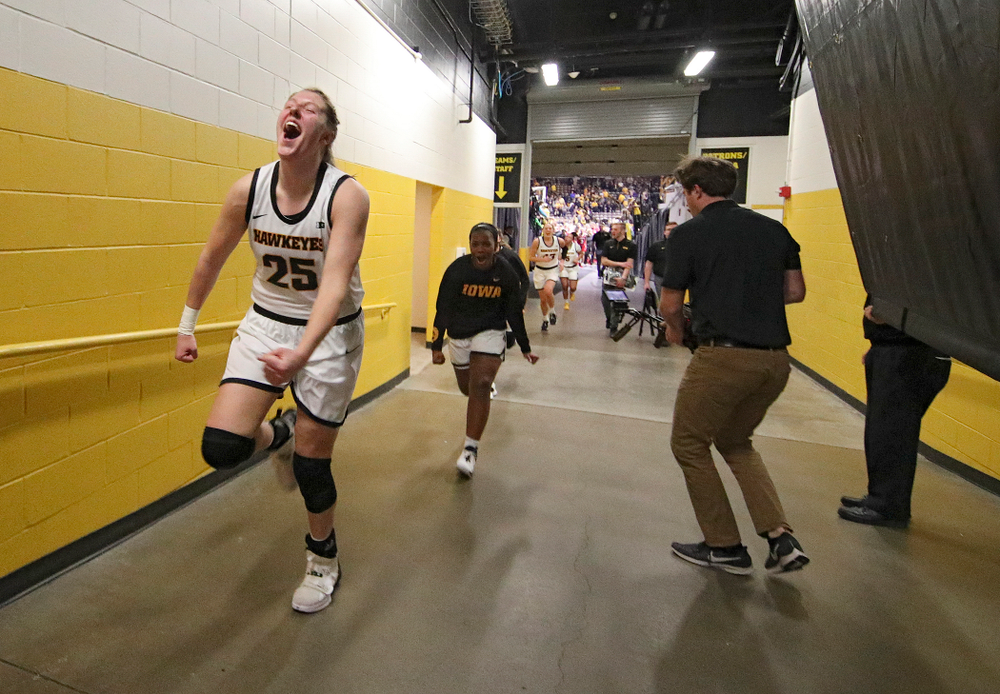 Iowa Hawkeyes forward Monika Czinano (25) celebrates as she runs back to the locker room after their double overtime win at Carver-Hawkeye Arena in Iowa City on Sunday, January 12, 2020. (Stephen Mally/hawkeyesports.com)