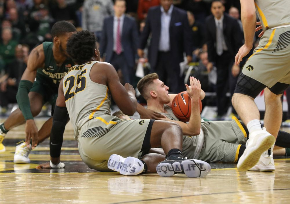 Iowa Hawkeyes guard Jordan Bohannon (3) and forward Tyler Cook (25) against the Michigan State Spartans Thursday, January 24, 2019 at Carver-Hawkeye Arena. (Brian Ray/hawkeyesports.com)