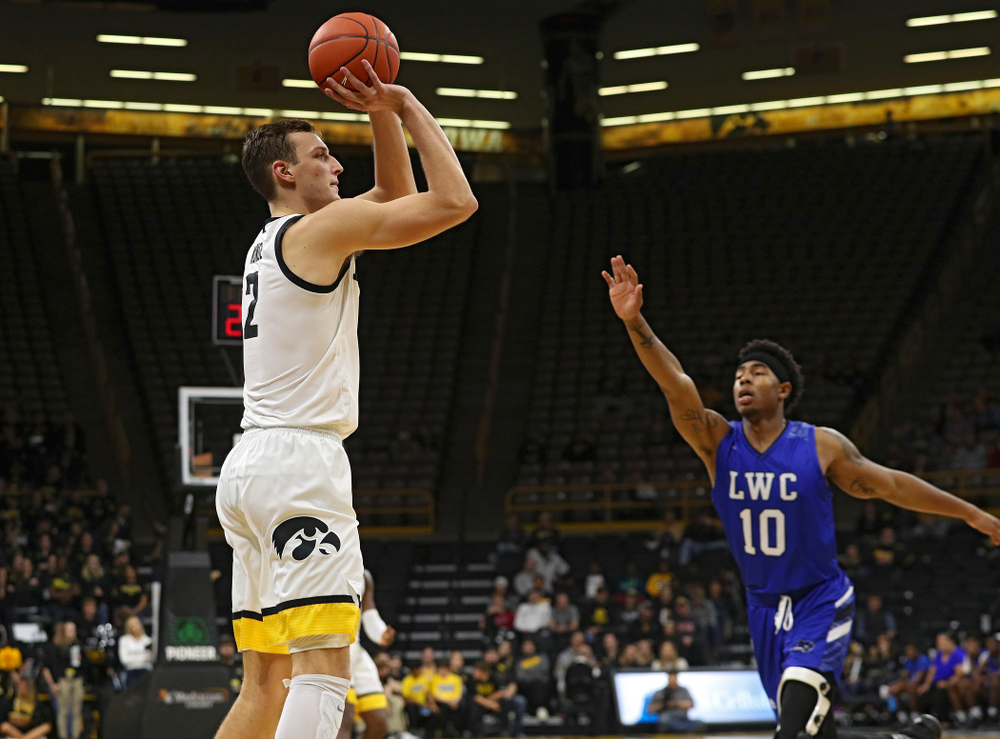 Iowa Hawkeyes forward Jack Nunge (2) puts up a shot during the second half of their exhibition game against Lindsey Wilson College at Carver-Hawkeye Arena in Iowa City on Monday, Nov 4, 2019. (Stephen Mally/hawkeyesports.com)
